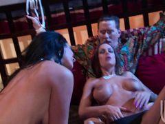 Сисястые лесбиянки ласкают друг друга рядом со связанным мужиком